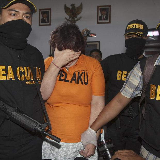 Lindsay Sandiford was paraded at a press conference wearing an orange prison T-shirt, flanked by masked, armed officers in Bali (AP)