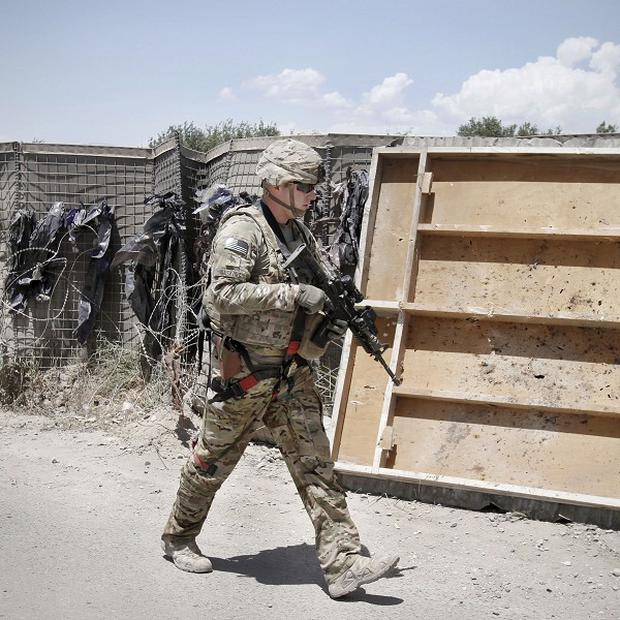 Afghan insurgents have attacked a Nato base in eastern Afghanistan (AP)