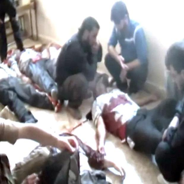 This image from amateur video released by Shaam News Network purports to show the bodies of Syrian workers killed near Qusair(AP)
