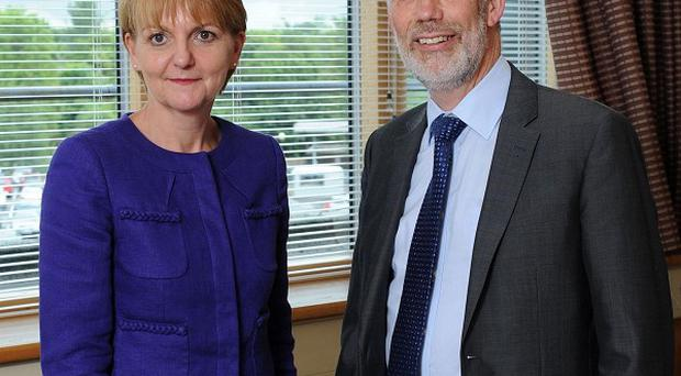 The new director general for Northern Ireland Prison Service Sue McAllister with Justice Minister David Ford (Stephen Hamilton/presseye/PA)