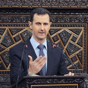 Syrian President Bashar Assad, as he delivers a speech at the parliament in Damascus (AP)