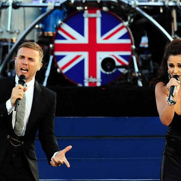 Gary Barlow and Cheryl Cole on stage at Buckingham Palace during the Diamond Jubilee Concert (PA)
