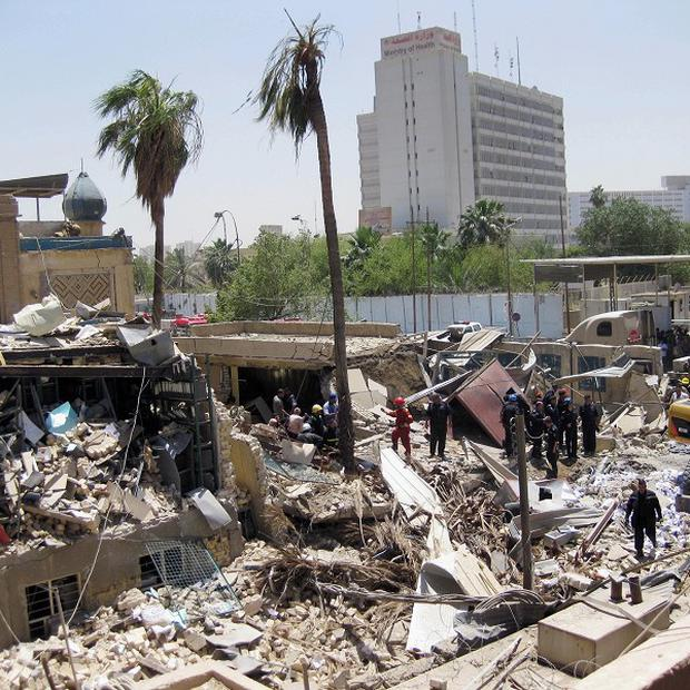The powerful car bomb tore the facade off of Iraq's main religious affairs office for Shiite Muslims in Baghdad (AP)