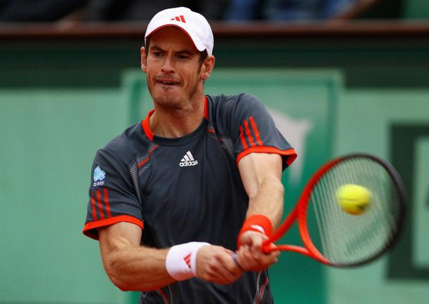 PARIS, FRANCE - JUNE 04: Andy Murray of Great Britain hits a backhand in his men's singles fourth round match against Richard Gasquet of France during day 9 of the French Open at Roland Garros on June 4, 2012 in Paris, France. (Photo by Clive Brunskill/Getty Images)