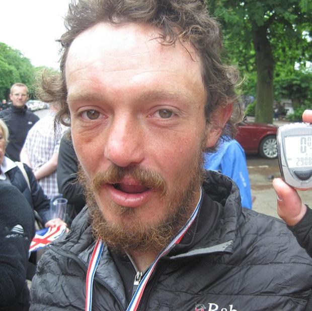Mike Hall has become the fastest person to circumnavigate the globe by bicycle