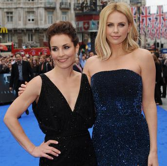 Noomi Rapace (left) and Charlize Theron arrive for the world premiere of Prometheus in Leicester Square, London