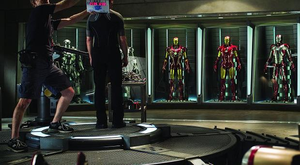 The Iron Man 3 image shows off some of the superhero's costumes