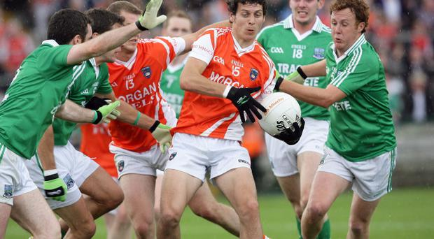 Jamie Clarke (centre) will shoulder a big responsibility in the Armagh attack on Sunday