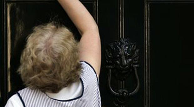 Done and dusted: A cleaner wipes the door entrance at 10 Downing Street, in central London