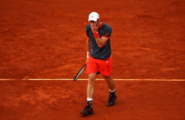 PARIS, FRANCE - JUNE 06: Andy Murray of Great Britain reacts during his men's singles quarter final match against David Ferrer of Spain during day 11 of the French Open at Roland Garros on June 6, 2012 in Paris, France. (Photo by Clive Brunskill/Getty Images)