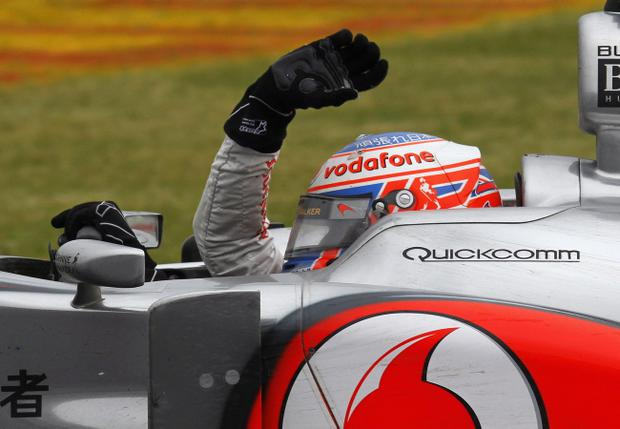 Jenson Button celebrates winning last year's Canadian Grand Prix