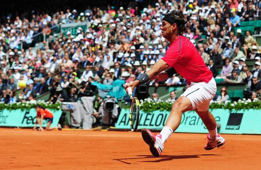 PARIS, FRANCE - JUNE 08: Rafael Nadal of Spain plays a forehand in his men's singles semi final match against David Ferrer of Spain during day 13 of the French Open at Roland Garros on June 8, 2012 in Paris, France. (Photo by Mike Hewitt/Getty Images)