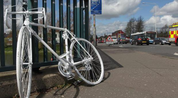 The ghost bike memorial on the Ormeau Bridge in South Belfast for Michael Caulfield a cyclist who is killed on the Ormeau road in April 2011.