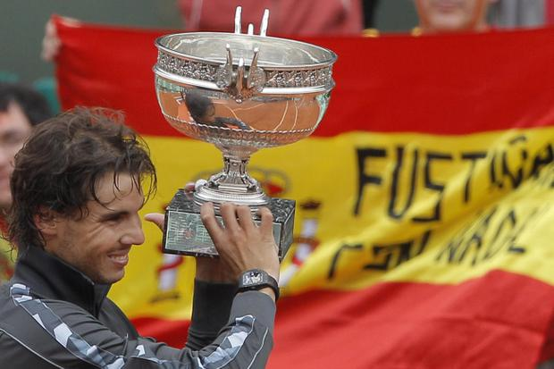 Rafael Nadal of Spain holds the trophy after winning the mens final match against Novak Djokovic of Serbia at the French Open tennis tournament in Roland Garros stadium in Paris, Monday June 11, 2012