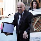 Business Secretary Vince Cable is planning to give shareholders greater power over bosses' pay