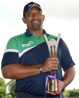Ireland coach Phil Simmons with the RSA Trophy