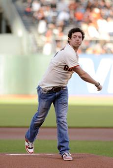 SAN FRANCISCO, CA - JUNE 12: 2011 US Open Golf Champion Rory McIlroy throws out the ceremonial first pitch of a Major League Baseball game between the Houston Astros and San Francisco Giants at AT&T Park on June 12, 2012 in San Francisco, California. (Photo by Thearon W. Henderson/Getty Images)