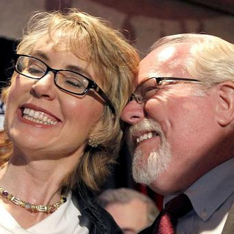Tucson shooting victim Gabrielle Giffords celebrates with Ron Barber after he won a special election to fill her seat in Congress (AP)