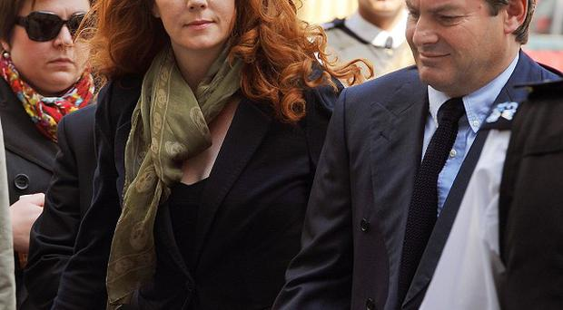 Former News International chief executive Rebekah Brooks and her husband Charlie arrive at Westminster Magistrates' Court