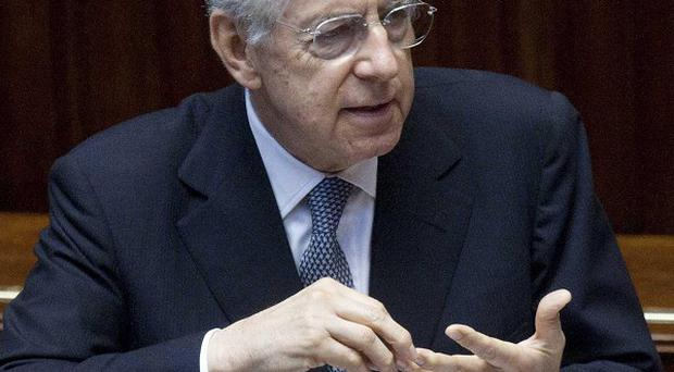 Italian Premier Mario Monti addresses the lower Chamber of Deputies in Rome (AP)
