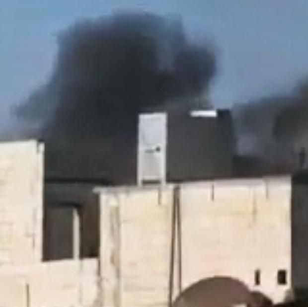 An image mad from amateur video shows black smoke rising from buildings in Homs, Syria (AP)