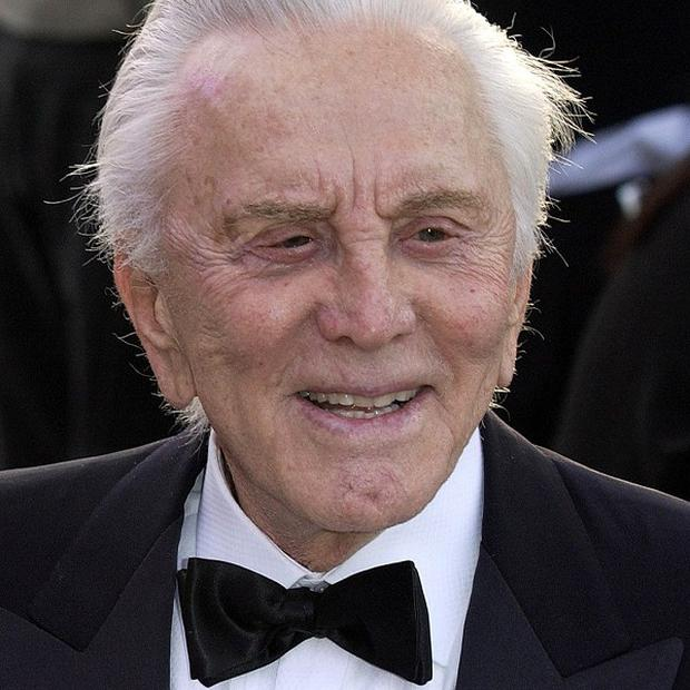 Kirk Douglas threw quarters to the crowd as he celebrated the launch of his book