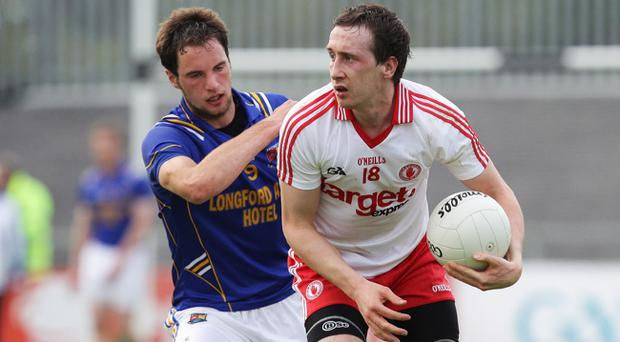 Colm Cavanagh (right) is an emerging talent at Tyrone whereas Kerry continue to rely on an ageing, albeit highly decorated, squad