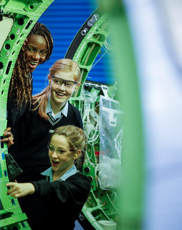 Year Elevens Zoe Phiri, Megan Wilson and Monika Dawson from Ashfield Girls' High School check out a Learjet 75 fuselage during a tour of Bombardier's fuselage manufacturing and assembly facility