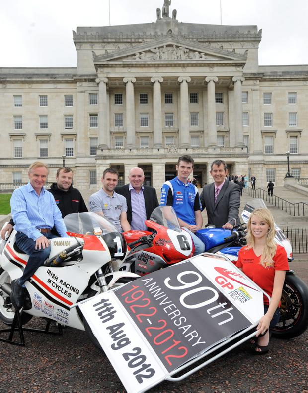 Ulster Grand Prix girl April Linton joins Clerk of the Course Noel Johnston, Minister Edwin Poots MLA and top road racers Brian Reid, William Dunlop, Bruce Anstey and Conor Cummins to launch the 2012 McKinstry Skip Hire Ulster Grand Prix at Stormont