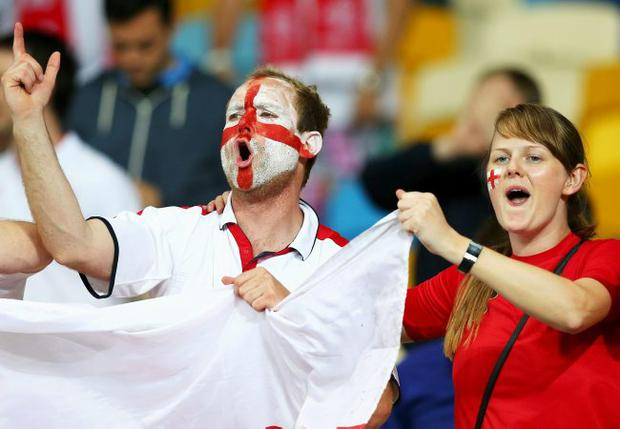 England fans celebrate during the UEFA EURO 2012 group D match between Sweden and England at The Olympic Stadium on June 15