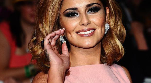 Cheryl Cole is the female celebrity with whom most straight women would like to share a kiss