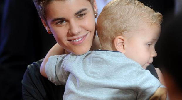 Justin Bieber and Jaxon Bieber arrive at the 2012 MuchMusic Video Awards at MuchMusic HQ on June 17, 2012 in Toronto, Canada.