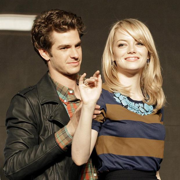 Andrew Garfield, left, and Emma Stone are the stars of The Amazing Spider-Man (AP)