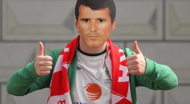 Republic of Ireland fan Paul Leonard wears a Roy Keane mask in the main square in Poznan, Poland