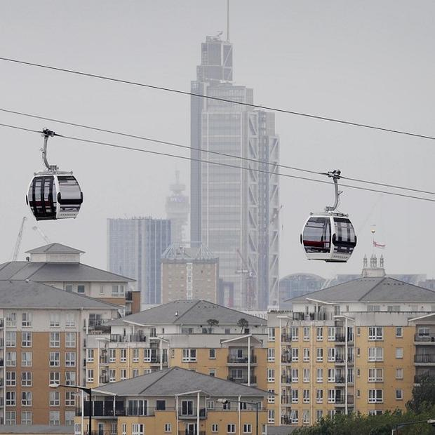 Cable car cabins above the River Thames in London on the Emirates Air Line, which is due to open next week