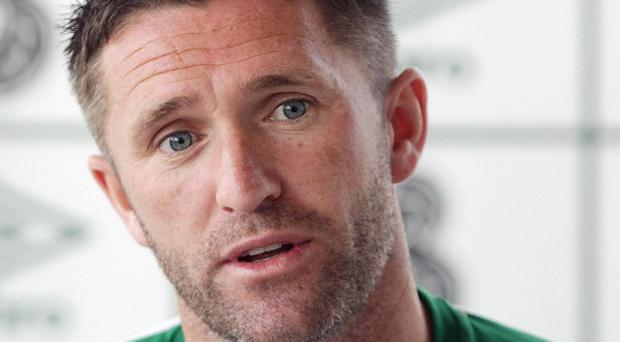 Robbie Keane says it is right that the Irish football team will wear black armbands during the Euro 2012 match against Italy