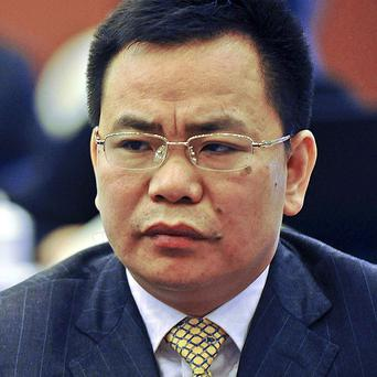 Chinese businessman Lin Chunping who invensted a fake bank, then claimed to have bought it (AP)