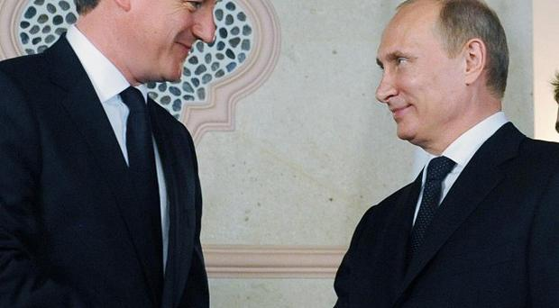 David Cameron holds a bilateral meeting with Russian President Vladimir Putin in Los Cabos, Mexico