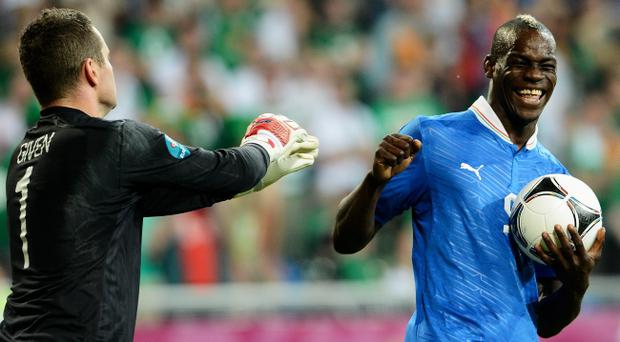 POZNAN, POLAND - JUNE 18: Mario Balotelli of Italy smiles at Shay Given of Republic of Ireland during the UEFA EURO 2012 group C match between Italy and Ireland at The Municipal Stadium on June 18, 2012 in Poznan, Poland. (Photo by Claudio Villa/Getty Images)
