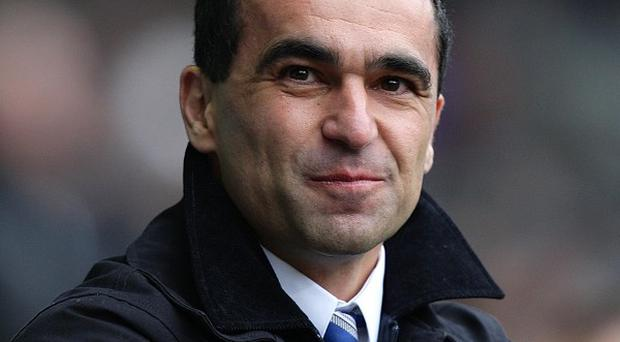 Wigan Athletic manager Roberto Martinez's side face Chelsea in the first game of the season