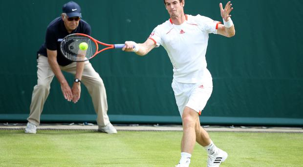 STOKE POGES, ENGLAND - JUNE 20: Andy Murray of Great Britain in action against Janko Tipsarevic during the Boodles Tennis at Stoke Park on June 20, 2012 in Stoke Poges, England. (Photo by Phil Cole/Getty Images)