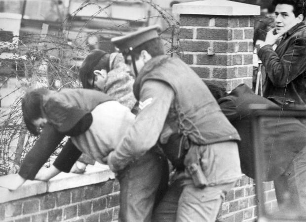 Riots : Belfast. January 1971. Soldiers frisking passengers and driver of a car on the Springfield Road, near Ballymurphy. (14/01/1971)