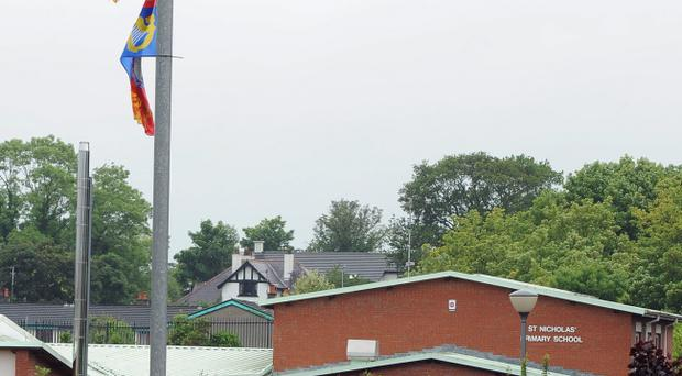 Paramilitary flags around the Woodburn Road area where St Nicholas' Church and St Nicholas' Primary School are located