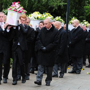 The funeral cortege of the Philpott children arrives at the church in Derby