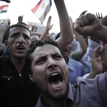 Egyptians chant slogans against the military in Tahrir Square,Cairo (AP)