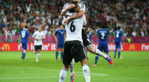 GDANSK, POLAND - JUNE 22: Sami Khedira of Germany celebrates scoring their second goal with Bastian Schweinsteiger of Germany during the UEFA EURO 2012 quarter final match between Germany and Greece at The Municipal Stadium on June 22, 2012 in Gdansk, Poland. (Photo by Joern Pollex/Getty Images)