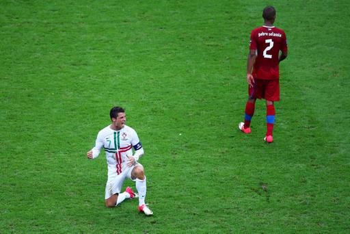 WARSAW, POLAND - JUNE 21: Cristiano Ronaldo of Portugal celebrates victory and progress to the semi-finals during the UEFA EURO 2012 quarter final match between Czech Republic and Portugal at The National Stadium on June 21, 2012 in Warsaw, Poland. (Photo by Michael Steele/Getty Images)