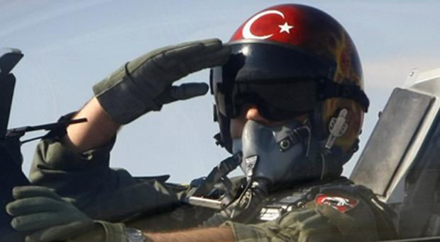 Turkey's foreign minister says a Turkish jet was downed in international airspace after it mistakenly entered Syria (AP)