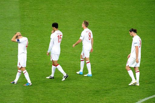 England's Steven Gerrard (left), Joleon Lescott (second left), Jordan Henderson (second right) and Andy Carroll appear dejected after losing on penalties during the UEFA Euro 2012 quarter final match at the Olympic Stadium, Kyiv