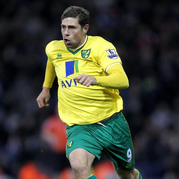 Grant Holt will wait to speak to the Norwich manager before deciding his future